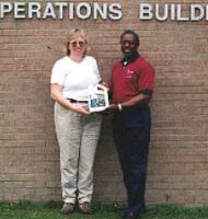 Grega St. John and Raymont Dentat the Operations Management International Inc. plant in Hinesville, Ga.